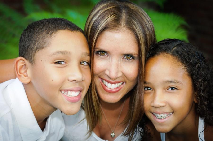 All smiles with this gorgeous family photo